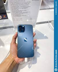 Trang, Thailand December - 6, 2020 : Customer Hold Iphone 12 Pro Max New  Pacific Blue Color With Information At Distribution Editorial Image - Image  of check, dark: 205030925