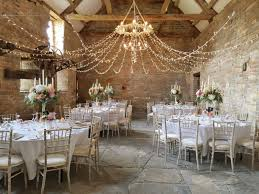 great barn wedding decoration in brick and chandelier