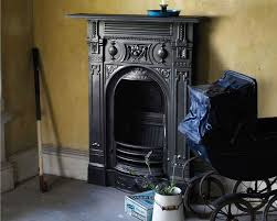 small victorian cast iron combination fireplace in black in period property