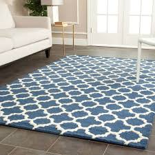 safa cambridge cam130g navy rug is a handmade rugs that is made from wool blend mainly use for indoor the rugs is rectangle in shape with attractive color