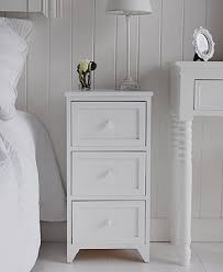 white bedside tables and cabinet the