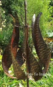 jonart metal jubilee bronzed wind spinner garden sculpture woodside garden centre pots to inspire