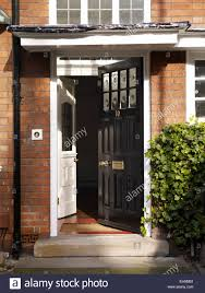 open traditional black front door of redbrick residential house kingsmead uk
