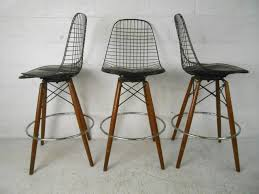 set of four midcentury modern barstools in the style of harry