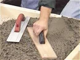 smooth out concrete with hand and bull floats