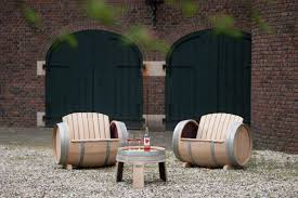 furniture made from barrels. this outdoor furniture handcrafted from old wine barrels is a wonderful addition to any backyard made s
