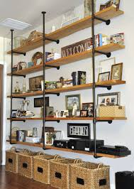 photo an blurb with a LINK to the site for actual How-to .wood and iron pipe  industrial shelves