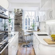 kitchen floor tiles with white cabinets. White Kitchen With Exposed Stone Pillar, Wood Flooring, Cabinetry And Granite Floor Tiles Cabinets