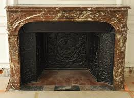 antique regence period fireplace in red from the north marble with its complete cast iron insert