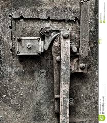 a grungy rusty old door locking mechanism weathered after years of being exposed to the elememts