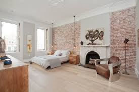 cozy bedroom design ideas with exposed brick wall