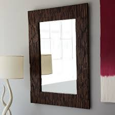 wood wall mirror. West Elm Mult-Panel Foxed Mirror Wood Wall