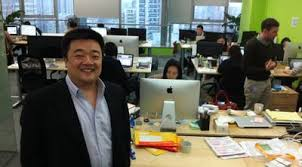 cramped office space. Bobby Lee, CEO Of BTC China, Stands In His Company\u0027s Cramped Office Space