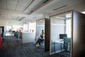 free office space. Businesswoman Texting With Cell Phone In Coworking Space Office Free S