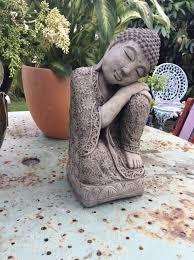 stone garden sleeping buddha statue