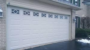 c h i desert tan short panel traditional garage door with waterton window pattern
