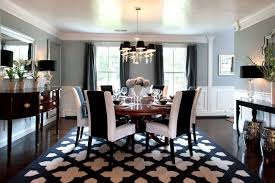 dining room with black rug
