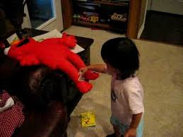 Ava Holt putting puzzle pieces on Elmo - YouTube