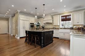 kitchen with white cabinets and black cabinet island with granite counter and glass pendant lighting