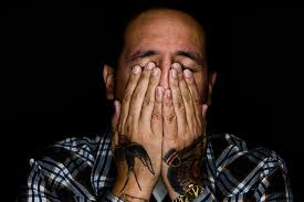 this tired man rubbing his eyes may be experiencing b12 deficiency
