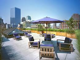 rooftop furniture. Decorations:Loft Mansion With Rooftop Lounge Also Pink Outdoor Furniture And Parasol Loft