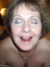 Busty granny gets her tits out on the beach Amateur Porn