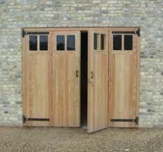 folding garage doorsTimber side hinged hormann garage door fitted in leicester