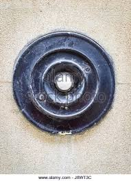 an old fashioned door bell on a building in cambridge uk stock image