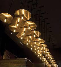 unique restaurant lighting ideas leds. interesting leds lighting concept for al dente restaurant brass discs carrying light and unique ideas leds