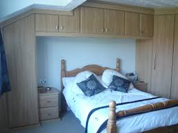 Made To Measure Bedroom Furniture Space Saving Fitted Bedroom Furniture A White Bedroom With A