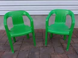 pair kids green chairs plastic stacking