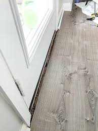 how installed a door threshold for vinyl flooring including we tackled installing the concrete look