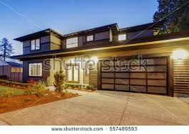 exterior siding for contemporary homes. new construction home exterior with contemporary house plan features low slope roof, brown siding and for homes -