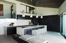 White kitchen pendant lighting Kitchen Island View In Gallery Sleek Kitchen In Black And White With Lovely Pendant Lighting Decoist 55 Beautiful Hanging Pendant Lights For Your Kitchen Island