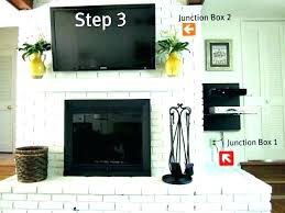 mounting a tv over fireplace mounted above hiding wires best mount where to put components