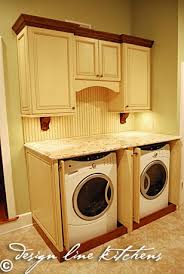 cabinets to hide washer and dryer. washer and dryer cover...good call, you dont have to worry about cabinets hide