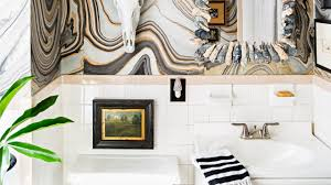 designer nicki clendening used sticky command arthanging hooks to affix this painting to the tile in