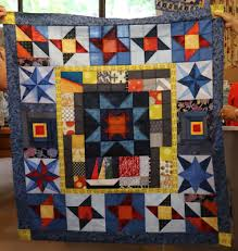 Fairholme Quilters & Pat built on the centre star block and most of the pieces inside the yellow  border, adding one block there and the outer borders for a very successful  and ... Adamdwight.com