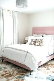 pink upholstered bed. Pink Tufted Bed Upholstered Frame Lovely Transitional Bedroom Is Lit By A Gray Sheer