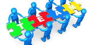 Team of People Fitting Puzzle Pieces Together to Create the Word Team