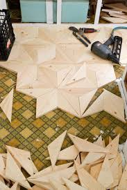 diy geometric wood floor might be a lot of work but gorgeous could be used for walls or tabletops too