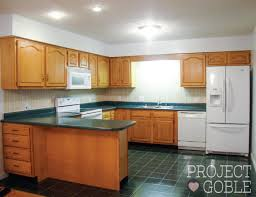 before kitchen transformation white cabinets painted counters with white appliances
