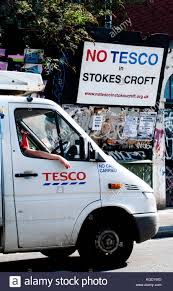 a tesco van parked near a sign opposing another tesco retail in bristol stock