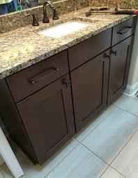 elegant raised master bathroom vanity with cherry cabinets granite countertopoen eva bronze fixtures with a white rectangle undermount sink