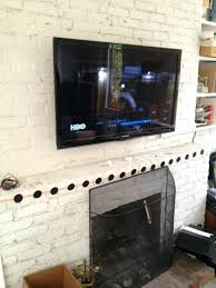 fireplace pull down tv mount over fireplace uk hanging brick mounted above cable box hide cables