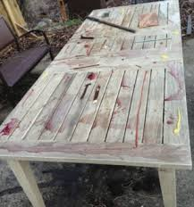 this weathered extension teak table has been exposed to outdoor weather for 4 months and has