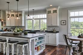 farmhouse kitchen remodel with black countertop white cabinets black top kitchen island with side open shelves