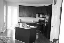 corner black wooden kitchen cabinets and rectangle kitchen island from black and white laminate kitchen cupboard
