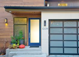 front door entryCarved wood doors entry contemporary with blue front door blue