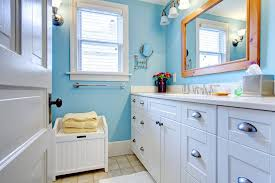 bathroom paint yellow. the echo blue wall paint and white vanities resemble nicely weathered skies, touched with bathroom yellow
